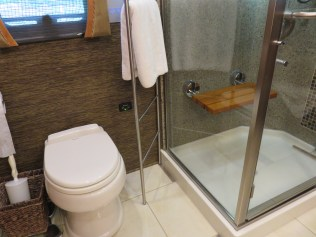 Shower seat down; toilet seat down; towel rack in position